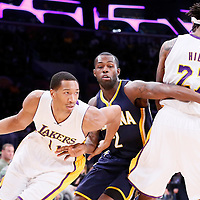 04 January 2014: Los Angeles Lakers forward Wesley Johnson (11) drives past Indiana Pacers guard Rodney Stuckey (2) on a screen set by Los Angeles Lakers center Jordan Hill (27) during the Los Angeles Lakers 88-87 victory over the Indiana Pacers, at the Staples Center, Los Angeles, California, USA.