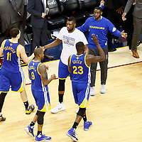 10 June 2016: Golden State Warriors center Festus Ezeli (31) congratulates Golden State Warriors guard Klay Thompson (11), Golden State Warriors forward Draymond Green (23) and Golden State Warriors forward Andre Iguodala (9) during the Golden State Warriors 108-97 victory over the Cleveland Cavaliers, during Game Four of the 2016 NBA Finals at the Quicken Loans Arena, Cleveland, Ohio, USA.