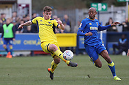AFC Wimbledon midfielder Jimmy Abdou (8) battles for possession with Oxford United midfielder Ryan Ledson (8) during the EFL Sky Bet League 1 match between AFC Wimbledon and Oxford United at the Cherry Red Records Stadium, Kingston, England on 10 March 2018. Picture by Matthew Redman.