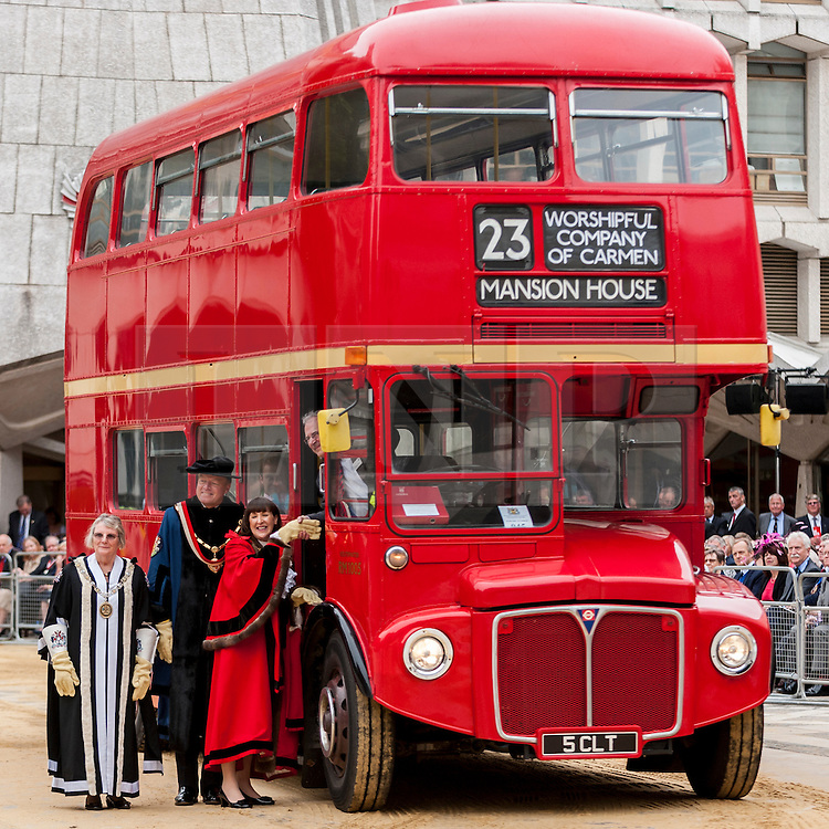 © Licensed to London News Pictures. 15/07/2015. London, UK. A Routemaster double-decker bus, driven by TFL commissioner, Sir Peter Hendy, whose last day with TFL is today. The historic Marking of Carts, run by The Worshipful Company of Carmen, took place in Guildhall.  Horse drawn carts, steam-powered and as modern modes of transport all received a branding as part of the ceremony.  Pictured second L to R: Chief Commoner, Deputy Billie Dove OBE, Sheriff Fiona Adler, Sir Peter Hendy.  Photo credit : Stephen Chung/LNP