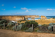 Landscape view of dramatic cliffs behind fence near the Loch Ard Gorge on the Great Ocean Road in Victoria, Australia