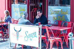 Edinburgh's Grassmarket bars and restaurants were doing brisk business today as the sun encouraged many visitors to the capital to eat and drink al fresco