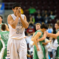 031314  Adron Gardner/Independent<br /> <br /> Laguna Acoma Hawk Ryan Arkie (31) clears the court as the Texico Wolverines celebrate after beating the Laguna Acoma Hawks 63-59 in the 2A boys semifinal game during the state high school basketball tournament at the Santa Ana Star Center in Rio Rancho Thursday.
