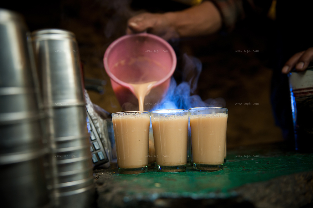 Scene from a group of motorcycle riders riding Royal Enfield bikes on a tour from Manali to Spiti in HImachal Pradesh Having chai at the dhaba at Betal, last stop before Kunzum pass leading from Lahaul to Spiti valley.