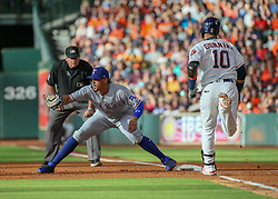 July 28, 2018 - Houston, TX, U.S. - HOUSTON, TX - JULY 28:  Texas Rangers first baseman Ronald Guzman (67) gets an out on Houston Astros first baseman Yuli Gurriel (10) in the bottom of the second inning during the baseball game between the Texas Rangers and Houston Astros on July 28, 2018 at Minute Maid Park in Houston, Texas.  (Photo by Leslie Plaza Johnson/Icon Sportswire) (Credit Image: © Leslie Plaza Johnson/Icon SMI via ZUMA Press)