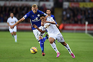 Jefferson Montero of Swansea city breaks way from Leicester city's Ritchie De Laet. Barclays Premier league match, Swansea city v Leicester city at the Liberty stadium in Swansea, South Wales on Saturday 25th October 2014<br /> pic by Andrew Orchard, Andrew Orchard sports photography.