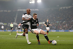 Derby County's Andre Wisdom and Fulham's Matt Targett battle for the ball during the match at Pride Park Stadium