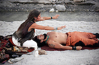 Woman holding owl claw during shamaic healing. Modern shamanic healer utilizing ancient technologies.