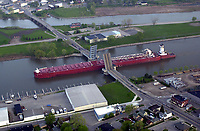 The integrated tug and barge unit known as an ITB named, Great Lakes Trader barge and the tug Joyce Banenkebort passes through the Lafayette Street Bridge in Bay City early Sunday morning on its way to unload stone at  Saginaw Rock Products Co. in Saginaw, Michigan.