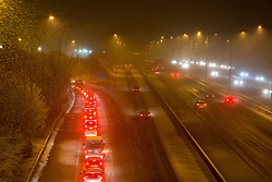 @Licensed to London News Pictures 12/01/2017. Maidstone, Kent. Commuters struggling with the sudden downfall of heavy snows on the M20 motorway in Maidstone, Kent.. Photo credit: Manu Palomeque/LNP