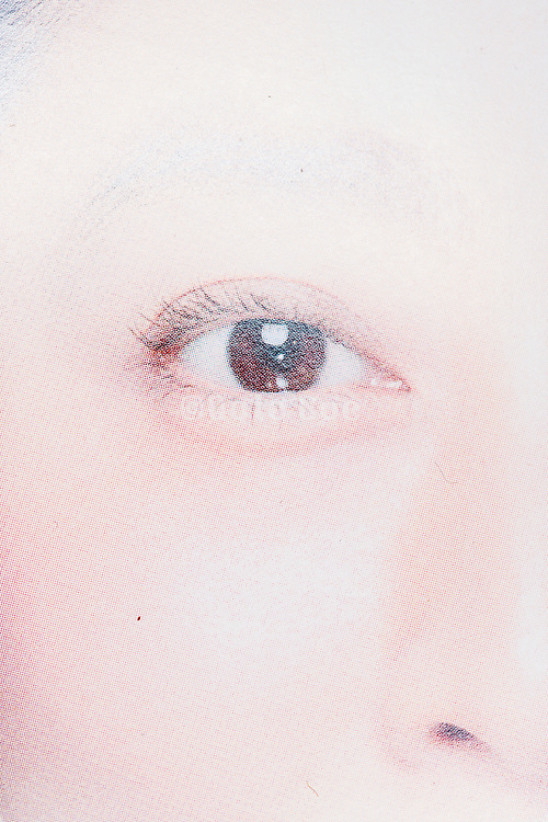 eye close up from print with halftone print dots