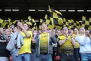 Watford fans celebrate after the final whistle as Watford celebrate there first win of the 2015/16 season. Barclays Premier League, Watford v Swansea city at Vicarage Road in London on Saturday 12th September 2015.<br /> pic by John Patrick Fletcher, Andrew Orchard sports photography.