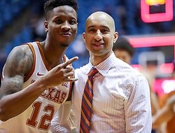 Feb 9, 2019; Morgantown, WV, USA; Texas Longhorns guard Kerwin Roach II (12) and Texas Longhorns head coach Shaka Smart pose for a photo after beating the West Virginia Mountaineers at WVU Coliseum. Mandatory Credit: Ben Queen-USA TODAY Sports