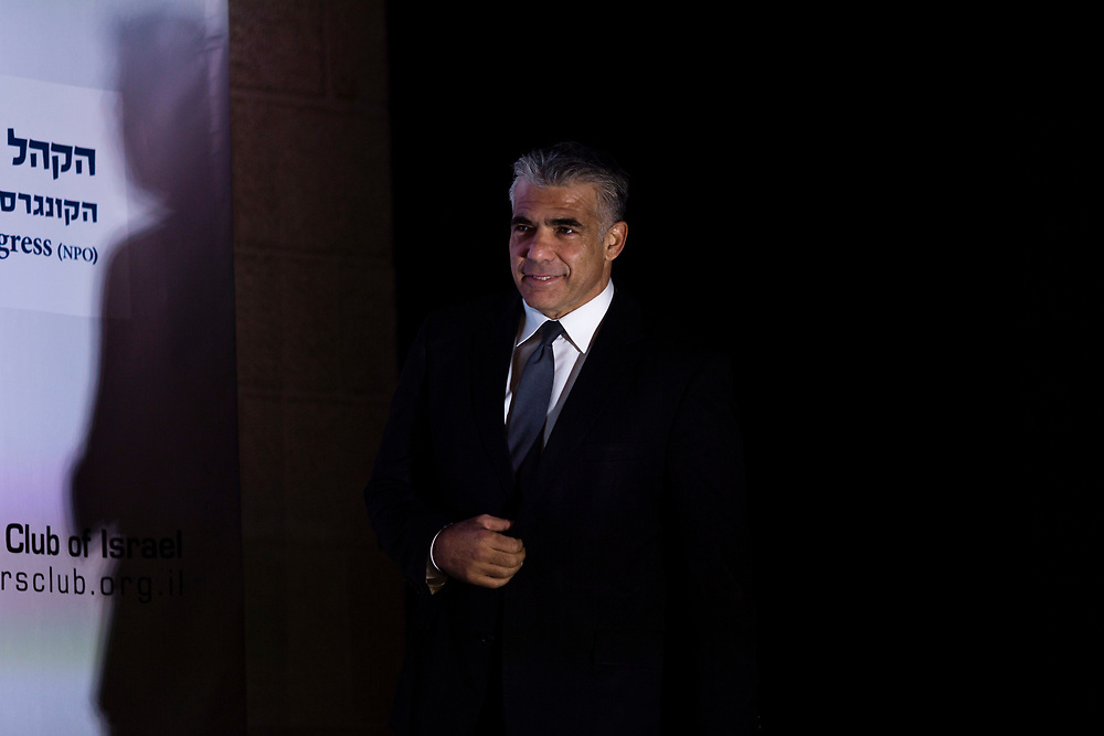 Israeli Member of the Parliament and leader of the Yesh Atid party, Yair Lapid arrives to address the Jerusalem Post Diplomats Conference in Jerusalem, Israel, on December 11, 2014.