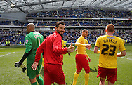 Watford Marco Motta celebrates during the Sky Bet Championship match between Brighton and Hove Albion and Watford at the American Express Community Stadium, Brighton and Hove, England on 25 April 2015. Photo by Phil Duncan.
