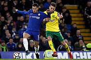 Eden Hazard of Chelsea (L) in action with Harrison Reed of Norwich City (R). The Emirates FA Cup, 3rd round replay match, Chelsea v Norwich City at Stamford Bridge in London on Wednesday 17th January 2018.<br /> pic by Steffan Bowen, Andrew Orchard sports photography.