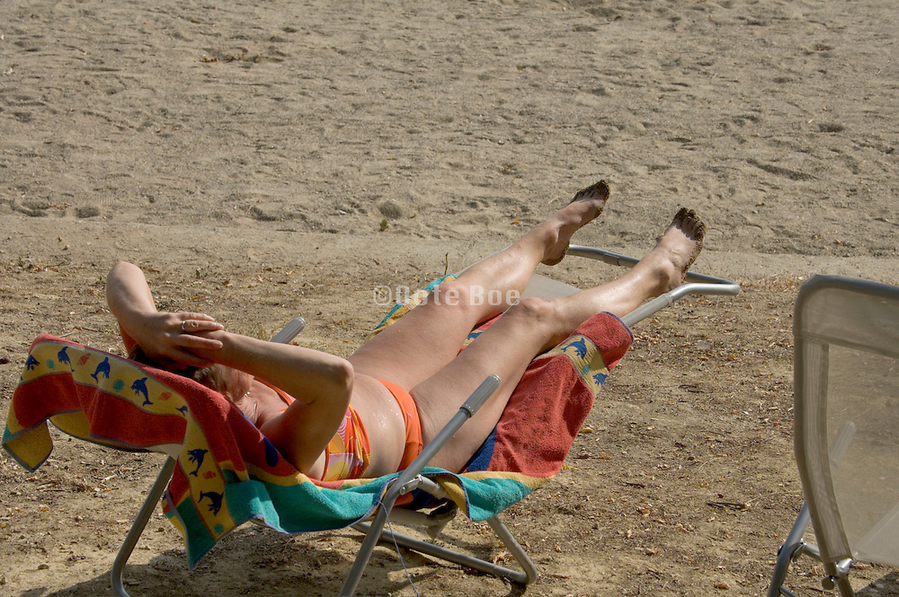 female person relaxing at a beach