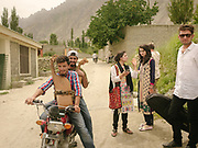 Young Wakhi men and women leaving the Bulbulik music school. Gulmit village.