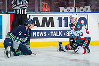 KELOWNA, CANADA - JANUARY 30:  Jarret Tyszka #5 of the Seattle Thunderbirds catches up with Conner Bruggen-Cate #20 of the Kelowna Rockets during pre-game on ice stretch on January 30, 2019 at Prospera Place in Kelowna, British Columbia, Canada.  (Photo by Marissa Baecker/Shoot the Breeze)