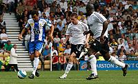 Photo: Steve Bond.<br />Derby County v RCD Espanyol. Pre Season Friendly. 04/08/2007. Darren Moore (L) closes down an Espanyol attack