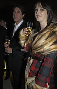 Bryan Ferry and Katie Turner, British Fashion Awards, V. & A. Museum. 2 November 2004. ONE TIME USE ONLY - DO NOT ARCHIVE  © Copyright Photograph by Dafydd Jones 66 Stockwell Park Rd. London SW9 0DA Tel 020 7733 0108 www.dafjones.com