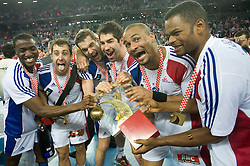 Luc Abalo (19), Michael Guigou (21), Guillaume Gille (5), Nikola Karabatic (13), Didier Dinart (3) and Daniel Narcisse (8) of France  celebrate after the 21st Men's World Handball Championship 2009 Gold medal match between National teams of France and Croatia, on February 1, 2009, in Arena Zagreb, Zagreb, Croatia. France won 24:19 and became World Champion 2009.  (Photo by Vid Ponikvar / Sportida)