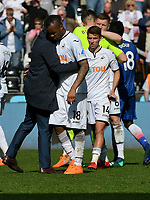 Football - 2017 / 2018 Premier League - Swansea City vs. Stoke City<br /> <br /> Jordan Ayew of Swansea City & s hugged by Swansea City manager Carlos Carvalhal of Swansea City looks sad as Swansea lose & are relegated, at The Liberty Stadium.<br /> <br /> COLORSPORT/WINSTON BYNORTH
