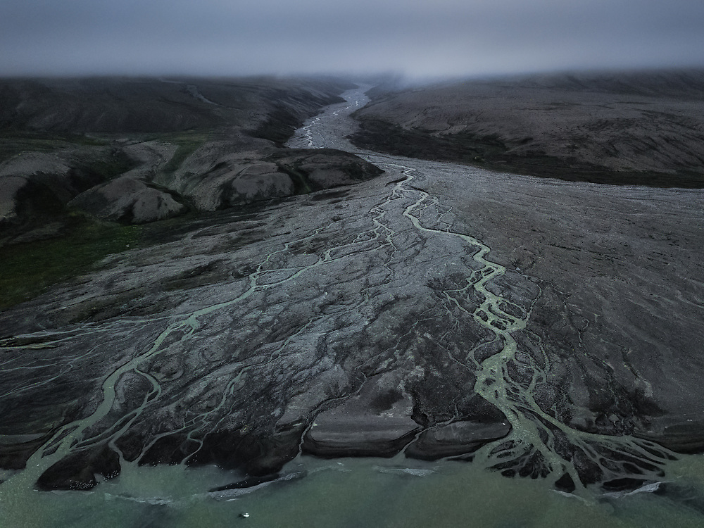 Glacier river flowing into the Uummannaq Fjord