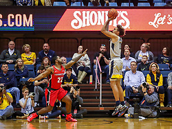 Dec 1, 2018; Morgantown, WV, USA; West Virginia Mountaineers forward Emmitt Matthews Jr. (11) shoots a three pointer during the first half against the Youngstown State Penguins at WVU Coliseum. Mandatory Credit: Ben Queen-USA TODAY Sports