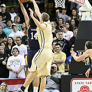 Central Florida center Tom Herzog (41) blocks a shot from Arsalan Kazemi (14) of Iran, during the first half of  a Conference USA NCAA basketball game between the Rice Owls and the Central Florida Knights at the UCF Arena on January 22, 2011 in Orlando, Florida. Rice won the game 57-50 and extended the Knights losing streak to 4 games.  (AP Photo/Alex Menendez)