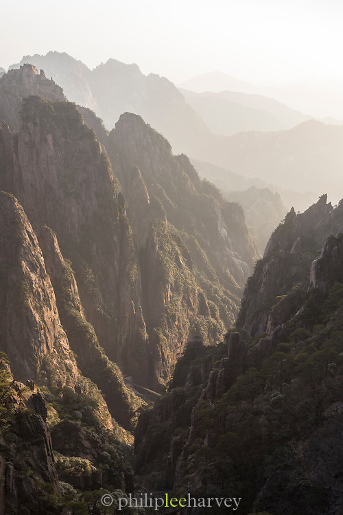 Huangshan Mountain Range, also known as Yellow Mountains, is a UNESCO World Heritage Site known for its scenery, sunsets, peculiarly-shaped granite peaks, Huangshan pine trees, hot springs, winter snow and views of the clouds from above, Anhui Province,China