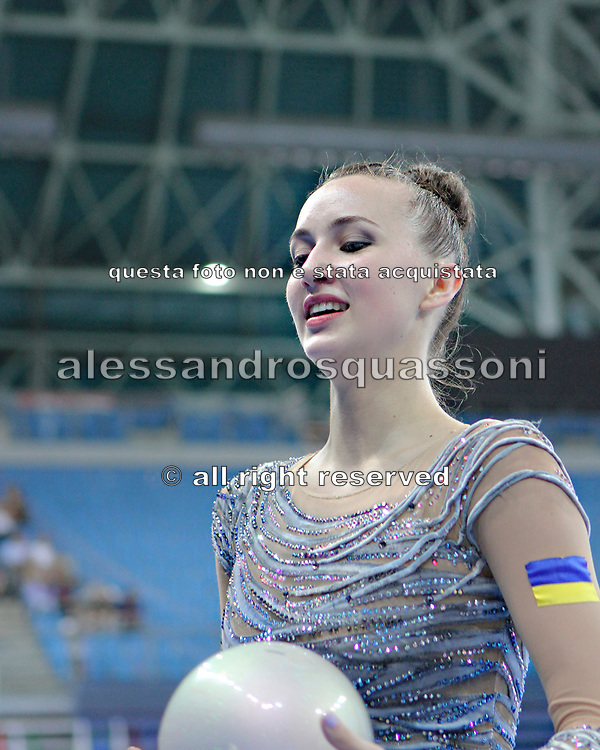 Rizatdinova Anna during final at ball in Pesaro World Cup at Adriatic Arena on April 28, 2013. Anna was born July 16, 1993 in Simferopol, she is a Ukrainian individual rhythmic gymnast.