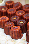 In a street food market in Bordeaux on the Quai des Chartrons: Canelés de Bordeaux, small cakes made from egg yolks, vanilla, caramel. Bordeaux Gironde Aquitaine France Europe caneles cannele canelles  Bordeaux Gironde Aquitaine France Europe