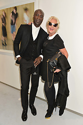 OZWALD BOATENG and AMANDA ELIASCH at a private view of Dancing Away featuring work by Mikhail Baryshnikov held at ContiniArtUK, 105 New Bond Street, London on 27th November 2014.