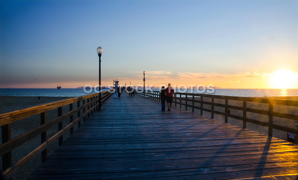 Couple Walking on the Seal Beach Pier at Sunset