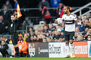 Fulham defender Denis Odoi (4) looking a bit perplexed as to why the throw-in is given to Oldham Athletic during The FA Cup 3rd round match between Fulham and Oldham Athletic at Craven Cottage, London, England on 6 January 2019.