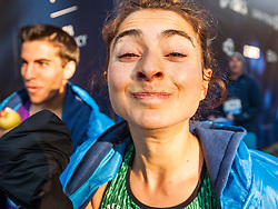Donn Cabral and Alexi Pappas bite apples
