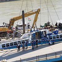 Rescue personnel work on lifting up the passenger boat Hableany (means Mermaid in Hungarian) from the river after it's capsize in an accident on river Danube in downtown Budapest, Hungary on June 11, 2019. ATTILA VOLGYI