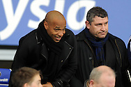 France and Arsenal legend Thiery Henry (l) watches the match in the crowd at Cardiff City Stadium. Skybet football league championship match, Cardiff city v Leeds Utd at the Cardiff city stadium in Cardiff, South Wales on Tuesday 8th March 2016.<br /> pic by Carl Robertson, Andrew Orchard sports photography.
