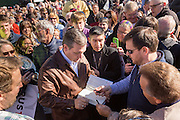 U.S. Senator and GOP presidential candidate Ted Cruz signs a copy of his book for a supporter during a campaign event at Ottawa Farms December 19, 2015 in Bloomingdale, Georgia.