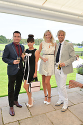 Left to right, GREG BURNS, ROXANNE PALLETT, RICK PARFITT JNR and RACHEL GRETTON at the Audi International Polo at Guards Polo Club, Windsor Great Park, Egham, Surrey on 26th July 2014.