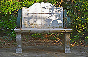 A white marble park bench in a shady corner in the garden. Clos des Iles Le Brusc Six Fours Cote d'Azur Var France