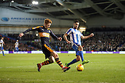 Newcastle United midfielder Jack Colback (4) clears the ball under pressure from Brighton & Hove Albion centre forward Sam Baldock (9) during the EFL Sky Bet Championship match between Brighton and Hove Albion and Newcastle United at the American Express Community Stadium, Brighton and Hove, England on 28 February 2017.