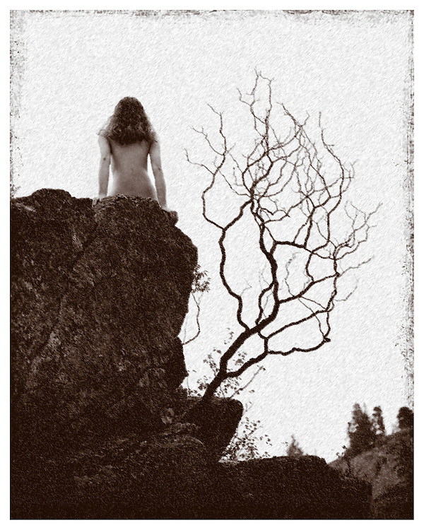 Angela Hunter, photographed in Kelowna, on a boulder, natural setting, discrete nude.