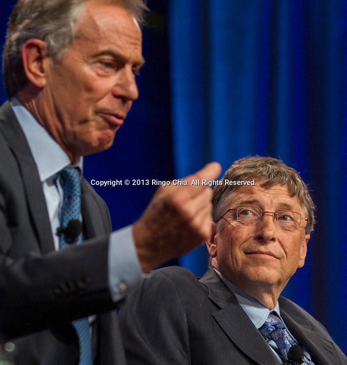 """Bill Gates, right, co-Chair and Trustee, Bill & Melinda Gates Foundation, looks on as Tony Blair, former Prime Minister of Great Britain and Northern Ireland, speaks in a panel """"Investing in African Prosperity"""" during the Milken Institute Global Conference on Wednesday, May 1, 2013 in Beverly Hills, California. (Photo by Ringo Chiu/PHOTOFORMULA.com)."""