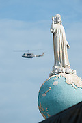 A military helicopter flies over the Plaza Salvador del Mundo (Savior of the World) as security was heightened as El Salvador celebrated the beatification ceremony and mass announcing the beatification of Archbishop Oscar Romero. The Archbishop was slain at the alter of his Church of the Divine Providence by a right wing gunman in 1980. Oscar Arnulfo Romero y Galdamez became the fourth Archbishop of San Salvador, succeeding Luis Chavez, and spoke out against poverty, social injustice, assassinations and torture. Romero was assassinated while offering Mass on March 24, 1980.