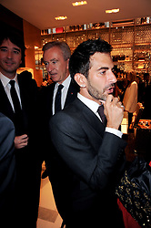 Left to right, BERNARD ARNAUD and MARC JACOBS at a party to celebrate the opening of the Louis Vuitton Bond Street Maison, New Bond Street, London on 25th May 2010.