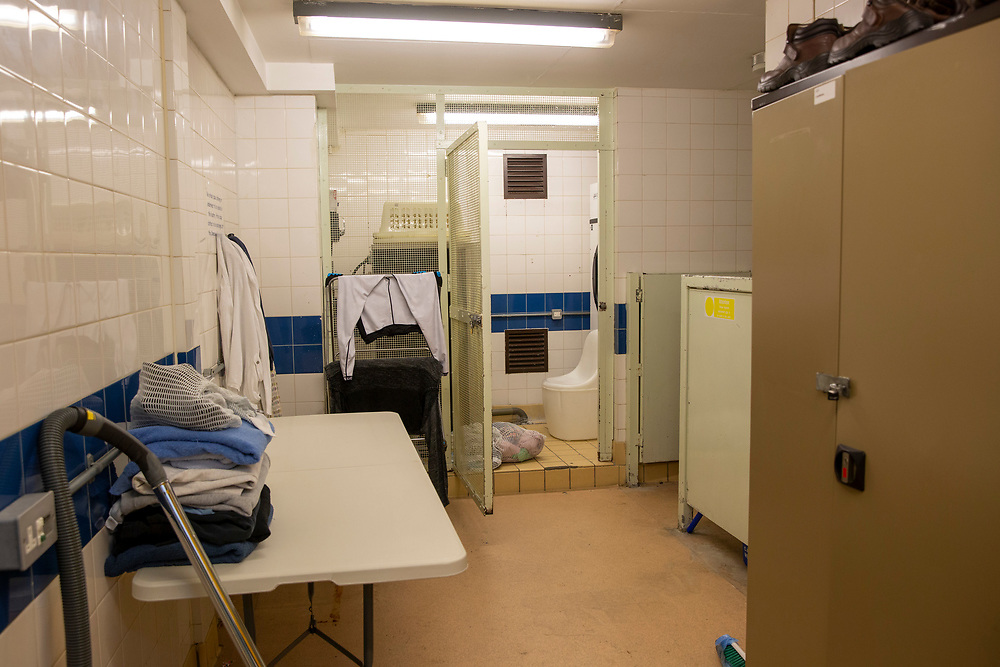 The laundry room for prisoners to clean their clothes in on B wing, inside HMP Downview, Surrey, United Kingdom. HMP Downview is a women's closed category prison for adult sentenced women and convicted and remand female young people located on the outskirts of Banstead in Surrey, England. (Picture credit: © Andy Aitchison)
