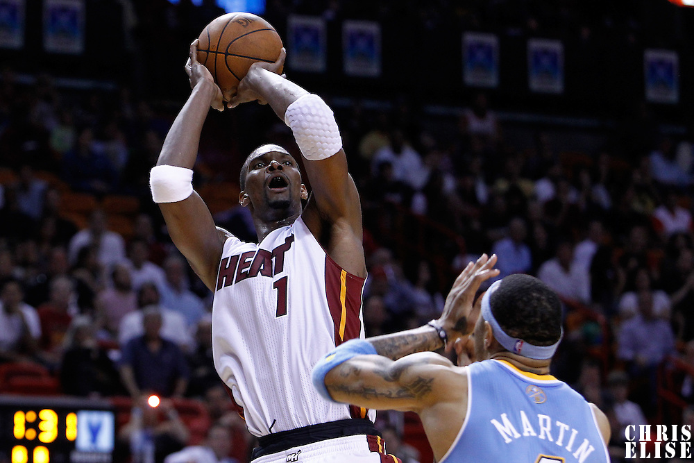 19 March 2011: Miami Heat power forward Chris Bosh (1) takes a jumpshot over Denver Nuggets power forward Kenyon Martin (4) during the Miami Heat 103-98 victory over the Denver Nuggets at the AmericanAirlines Arena, Miami, Florida, USA.