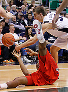Arizona forward Kevin Parrom, bottom, and BYU guard Kyle Collinsworth, top, battle for a loose ball during the second half of an NCAA college basketball game, Saturday Dec. 11, 2010 in Salt Lake City. BYU defeated Arizona 87-65.  (AP Photo/Colin E Braley)